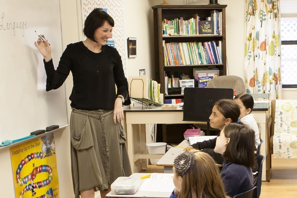 Teacher teaching the girls