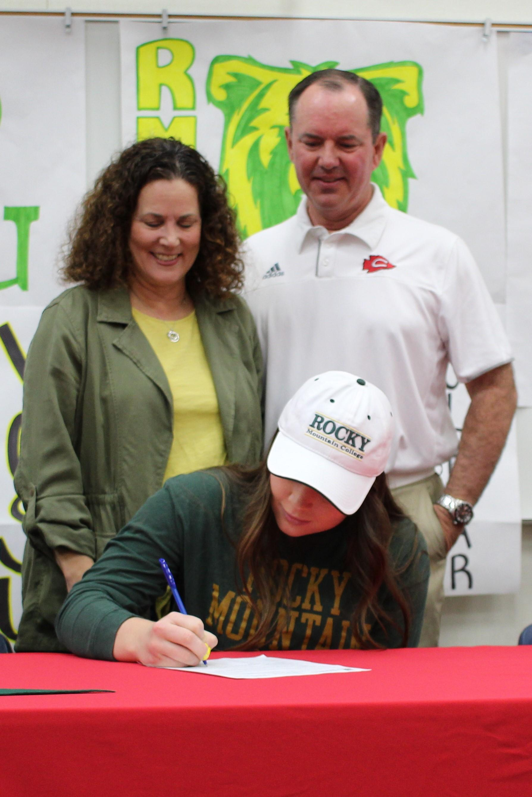 Claire Wright signs her National Letter of Intent to Attend Rocky Mountain College in Billings Montana to play golf.