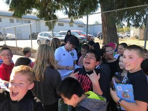 Portland Timbers player signs autographs
