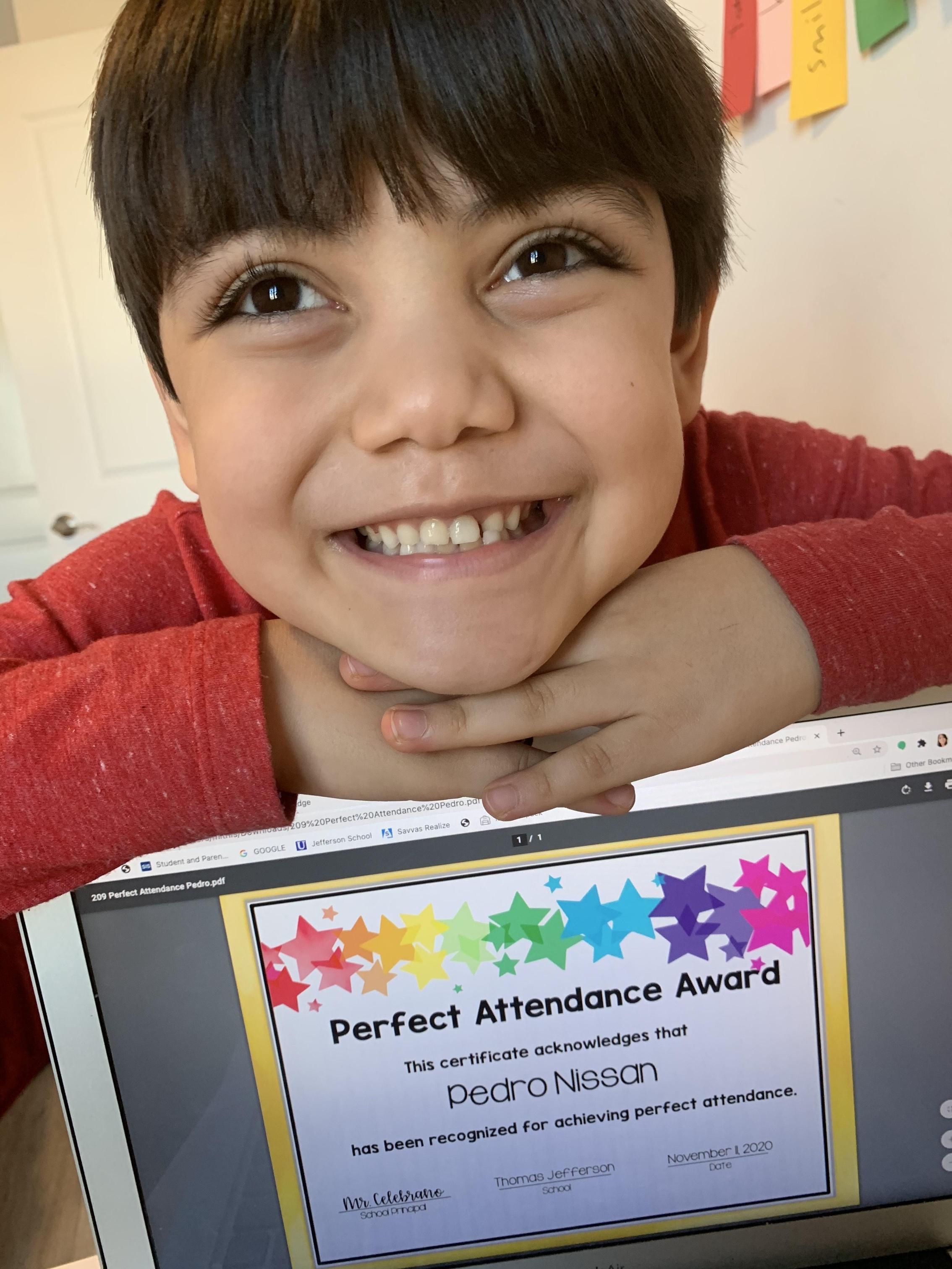 Pedro Nissan smiling with perfect attendance certificate