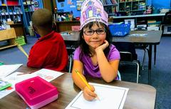 Kindergarten girl drawing a picture