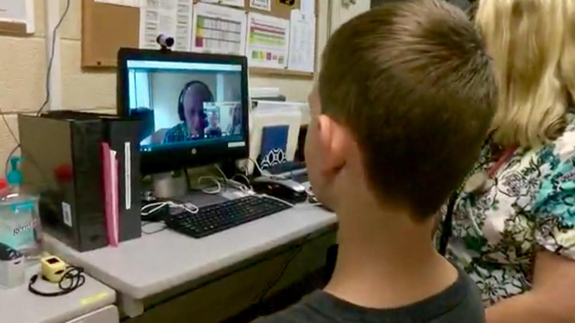 Nurse Angie uses the telemed system on a student