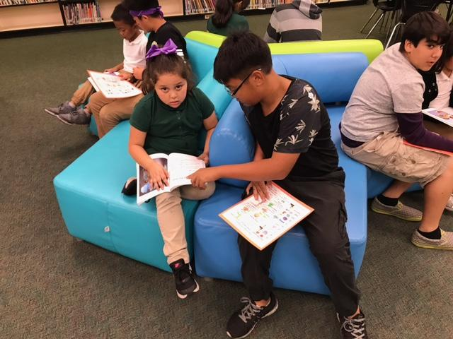 CCA students read help teach others.