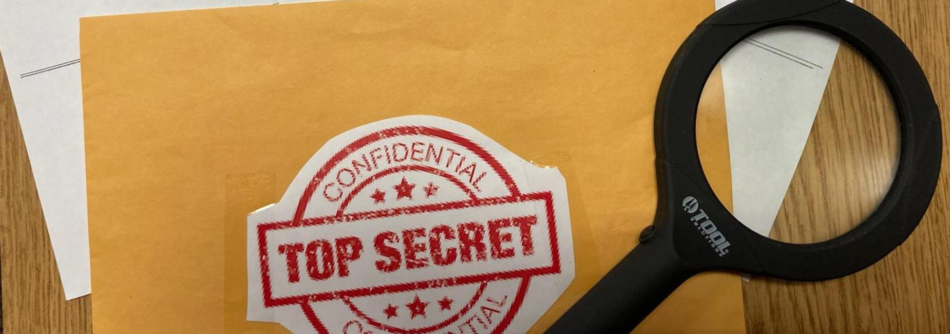 Envelope labeld Top Secret with Magnifying glass