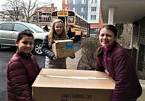 Photo of Franklin students unloading boxes of toys for donations