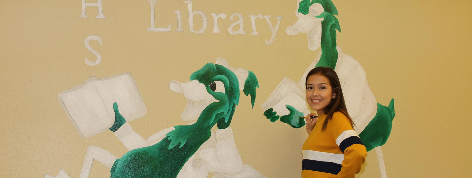 Student artist painting ducks