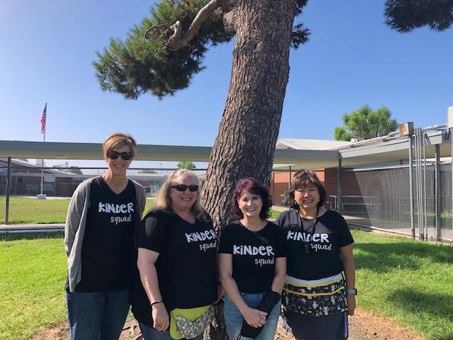 4 teachers standing