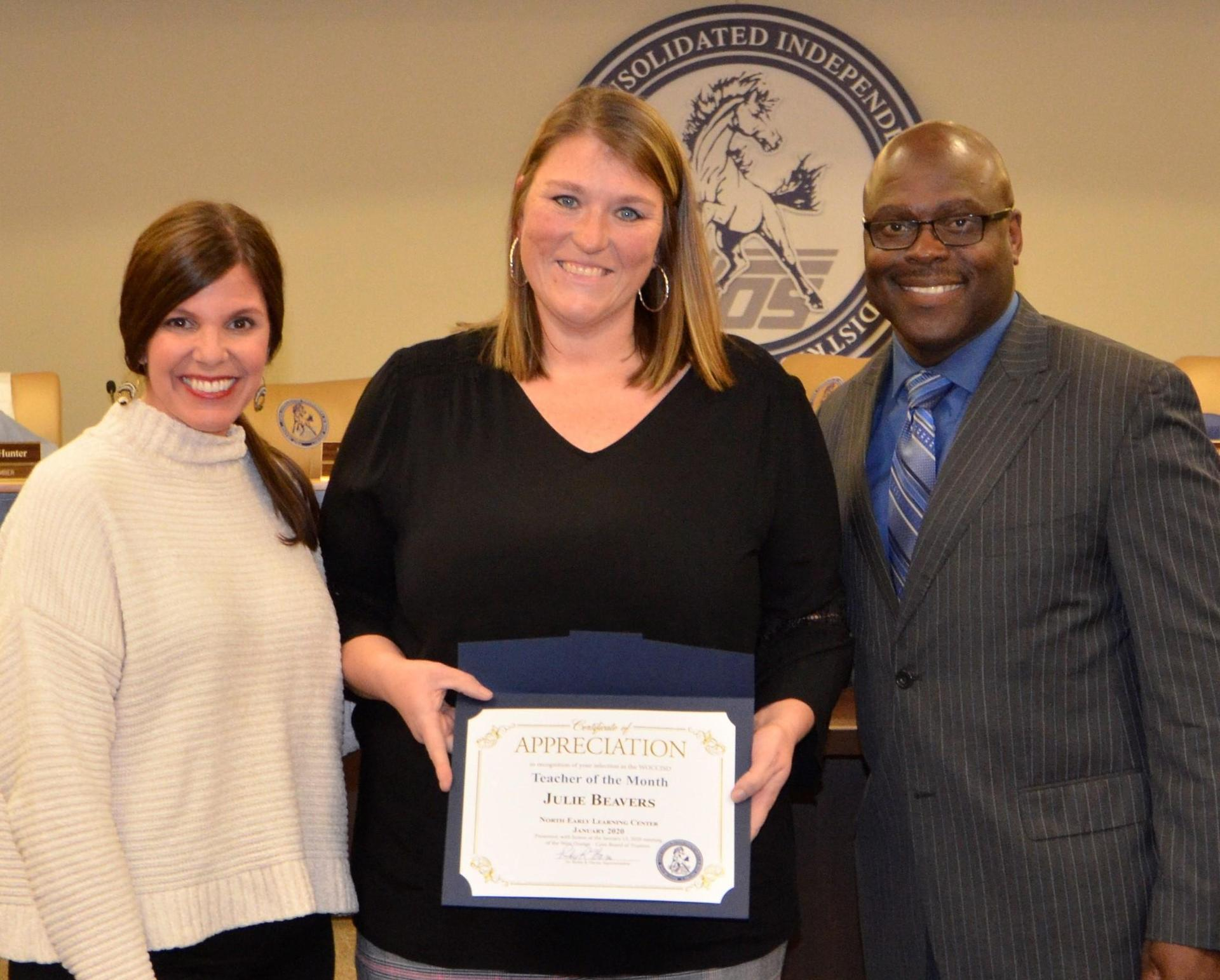 January 2020 Teacher of the Month, Julie Beavers, pictured with NELC Principal Vickie Oceguera and Superintendent Dr. Rickie Harris