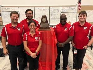 MHS Band Directors with their award