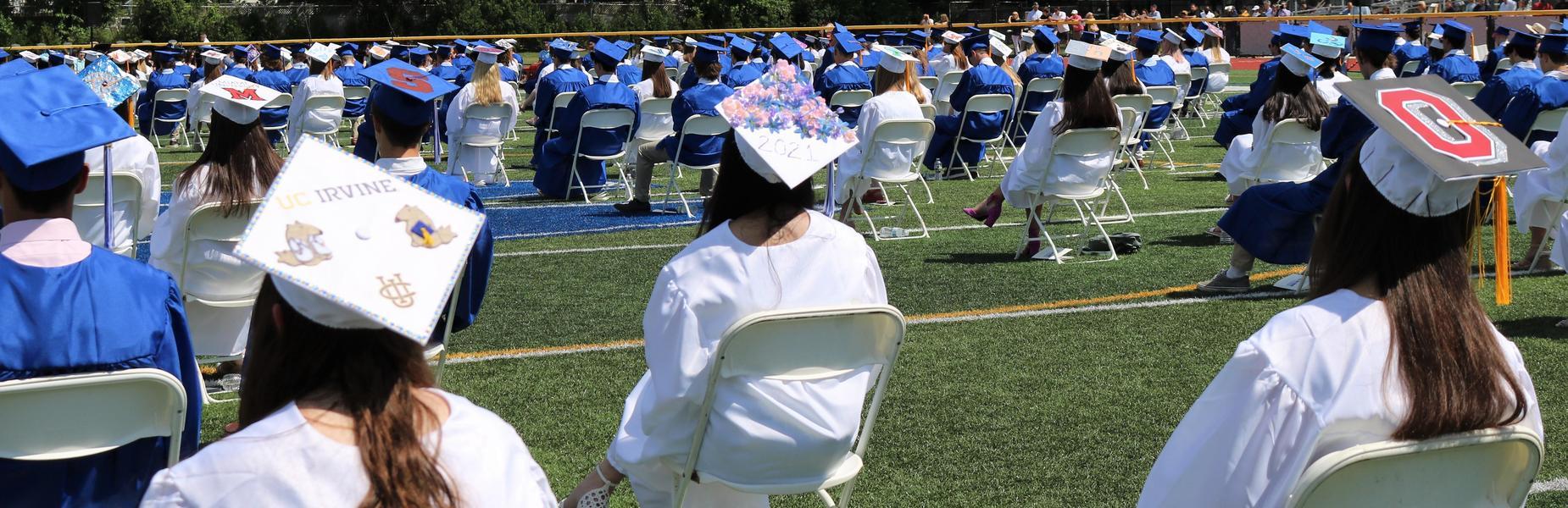 Photo of decorated graduate caps.