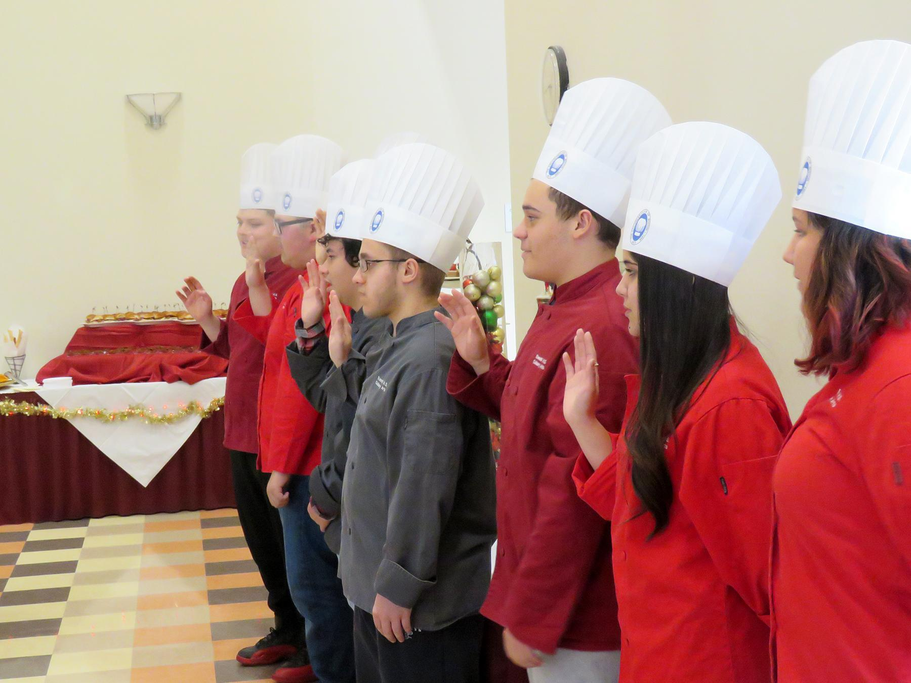 Students take the oath as junior members of the American Culinary Federation
