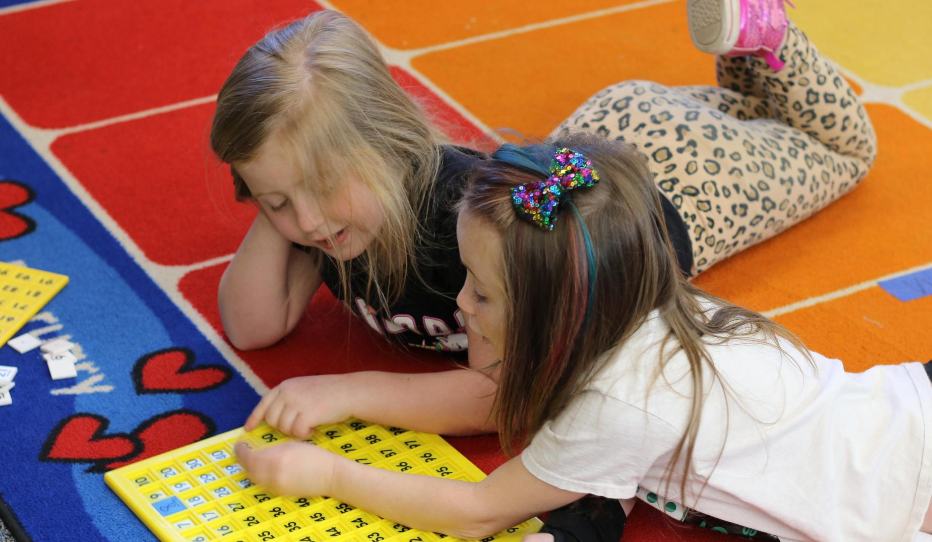CES kindergartners work on numbers panel