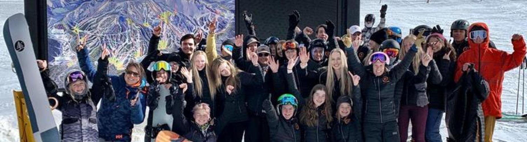 Students posing for picture in snow
