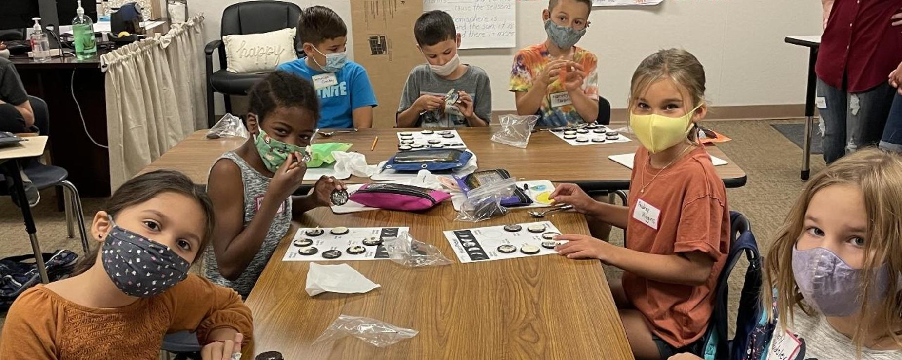 Students creating phases of the moon with oreos!