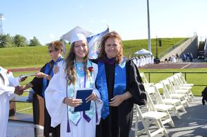 Emily McLaughlin poses with Board Director Ferrandez after receiving her diploma
