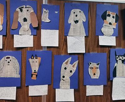Dog pictures made from torn paper.