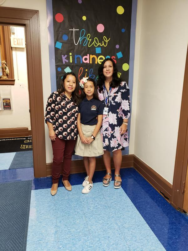 Isabella with her mom and Ms. L with a perfect PARCC math score