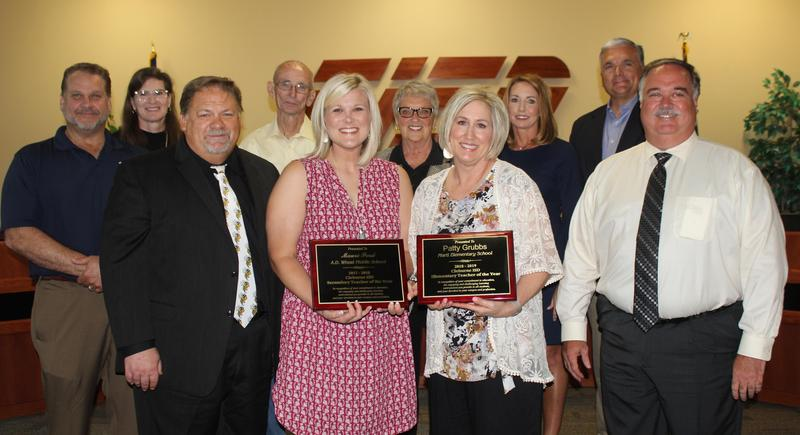 photo of elementary and secondary teachers of the year with Trustees