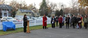Jefferson principal Dr. Susie Hung addresses a family, colleagues, and friends of veteran educator Mary Jo Juelis as a the school community unveiled a memorial bench in her honor in November.  Mrs. Juelis passed away in 2017.