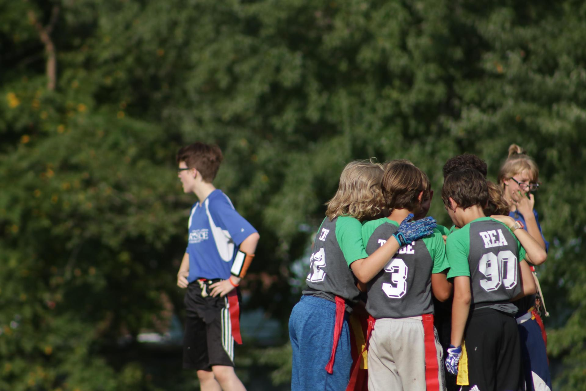 A team huddles up during flag football