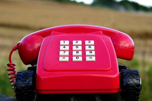 Red Desktop Phone With Wheels