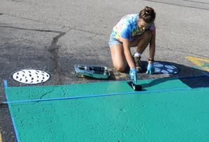 TKHS senior Jaydynn Schut works on painting her senior parking space.