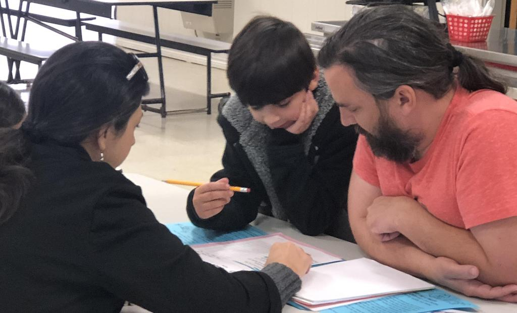 Student working with parent.