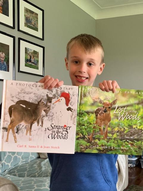 a student holding nature books
