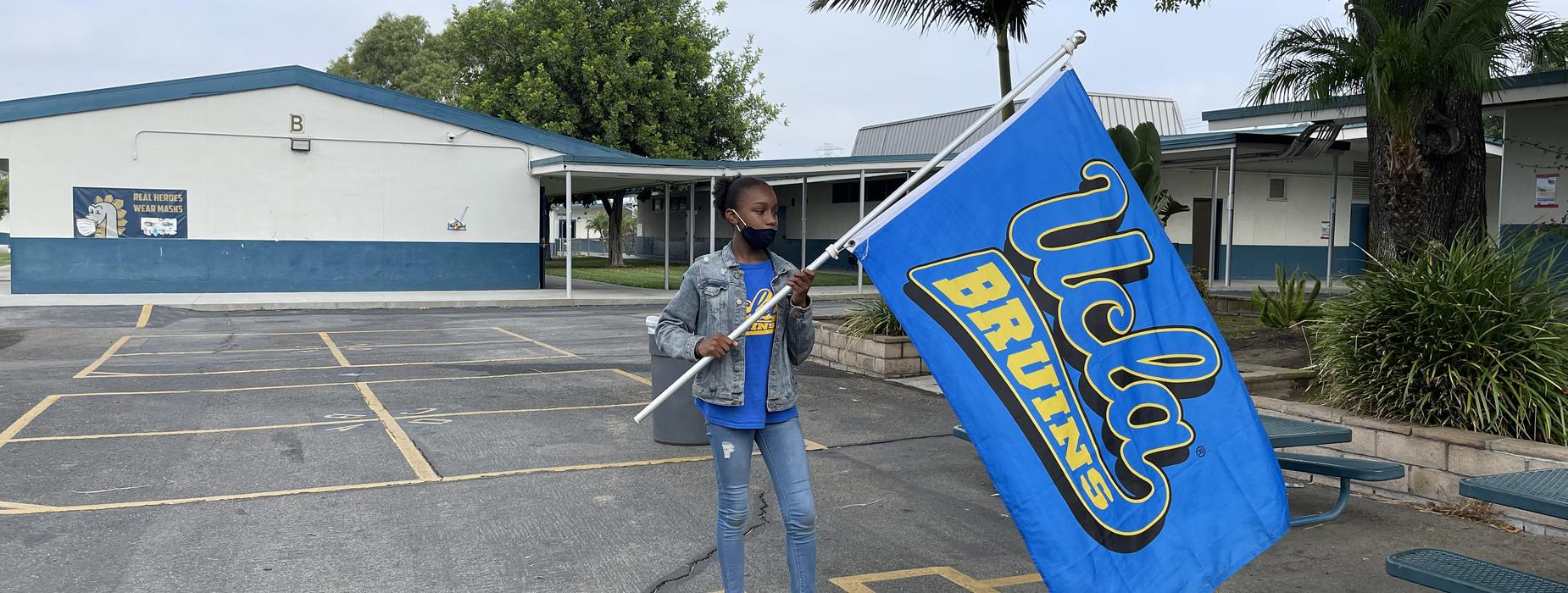 UCLA flag and student