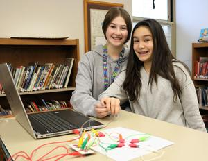 Photo of two Roosevelt Intermediate School students enjoying makerspace activities in recognition of New Jersey Maker Day in March 2019.