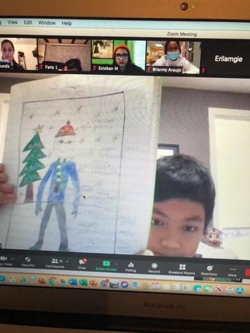 Boy showing Christmas clothes drawing on zoom