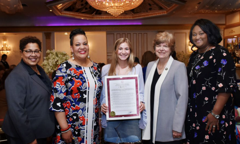 Photo of WHS Senior Jaimie DeDea with Union County Freeholders as they present her with the