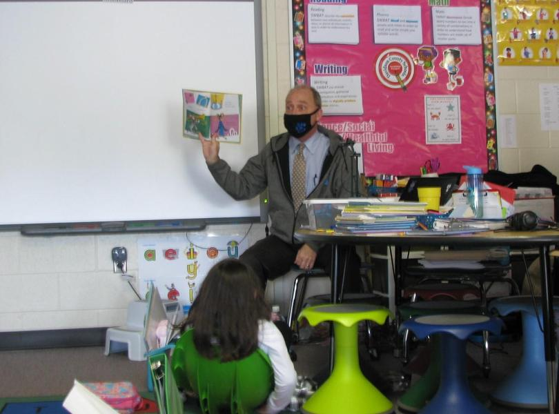 Mr. Reynolds celebrates Dr.Seuss's Birthday by reading one of his favorite books aloud to students.
