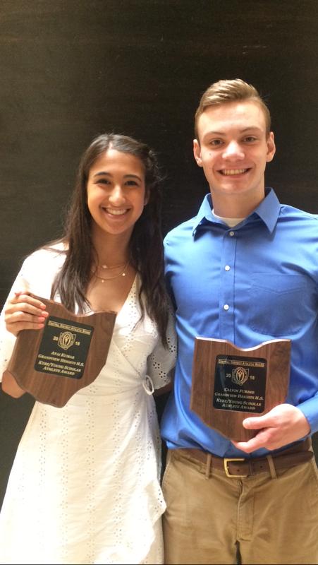 Photo of Avani and Calvin holding awards