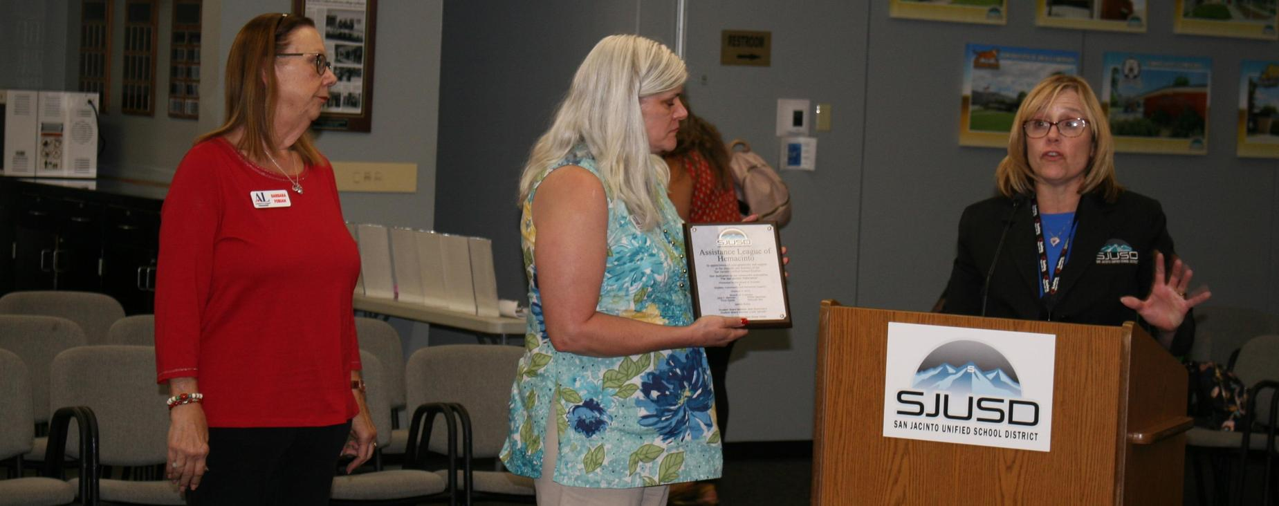 Deputy Supt Sherry Smith gave recognition to the Assistance League of Hemacinto for their support of students through Operation: School Bell at the October board meeting.