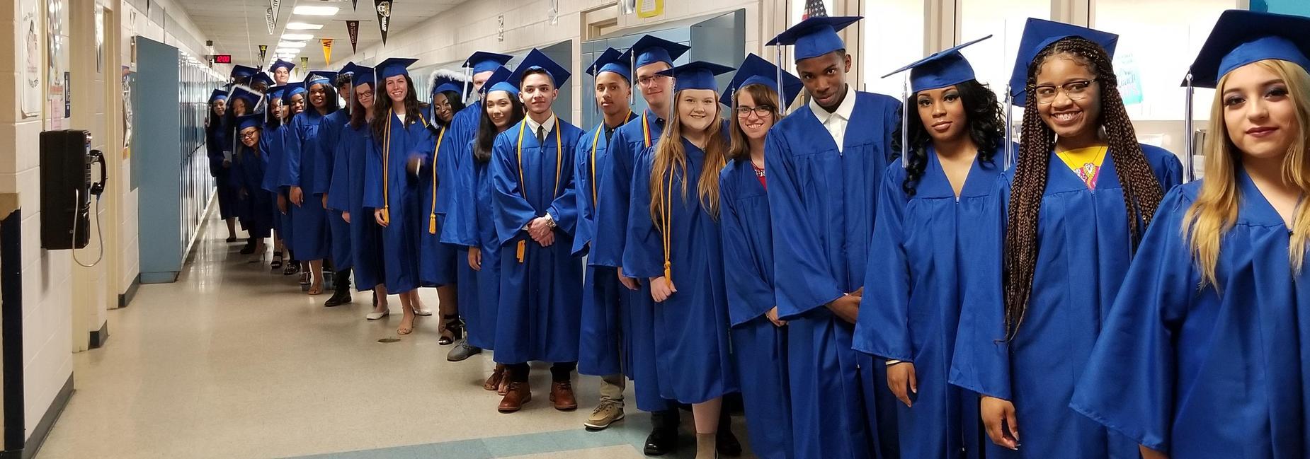 Class of 2018 Graduates standing in hallway