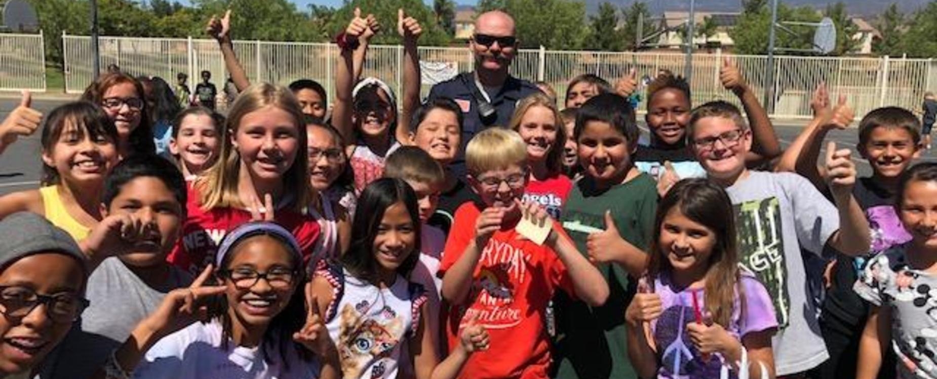 Students taking a picture with Officer Bronstroup