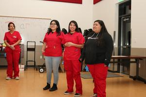 Medical Math students share during board meeting