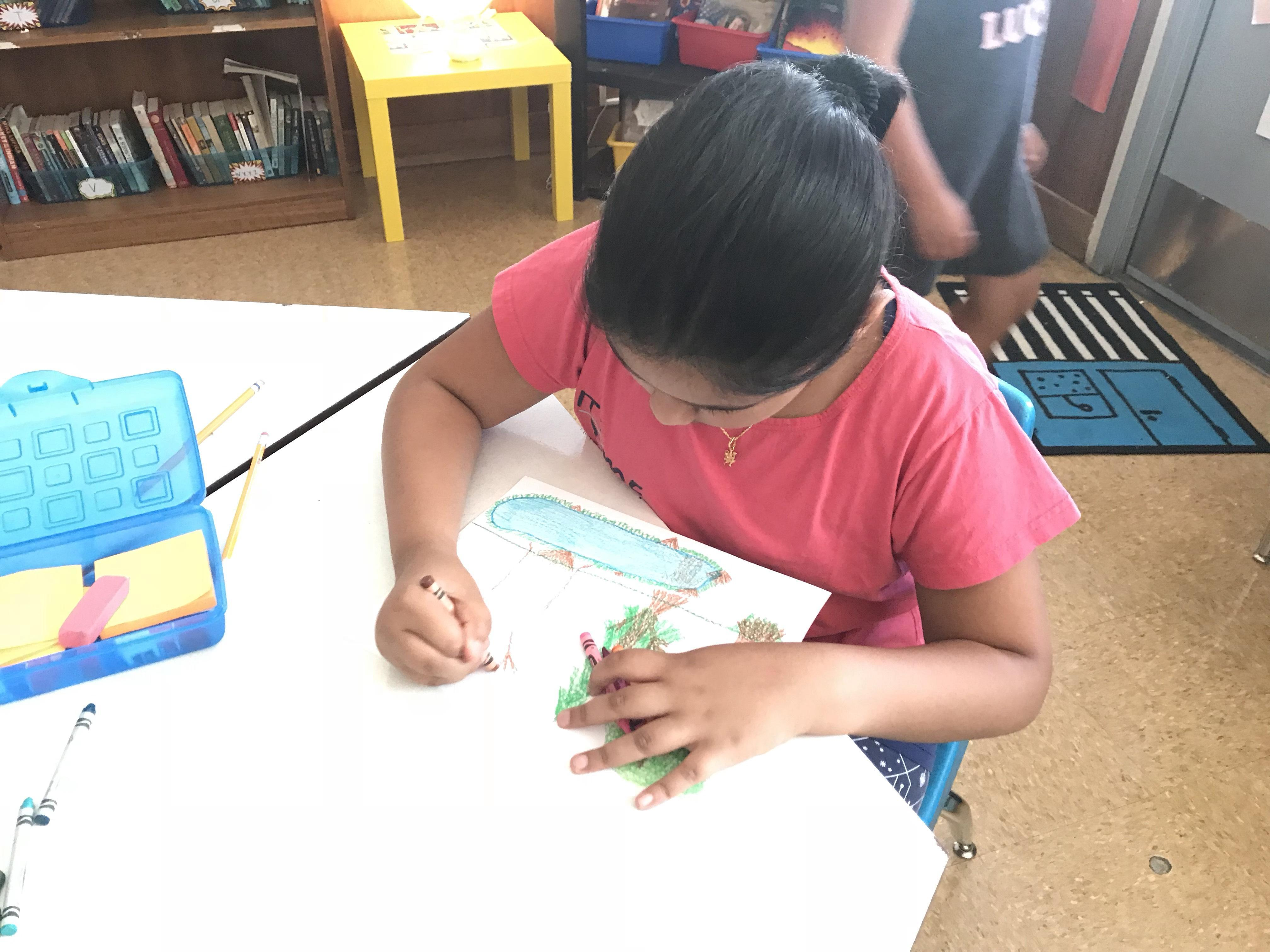student drawing her