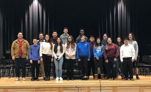 17 high school musicians posed on the stage