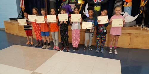 3rd grade students with awards