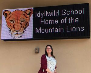 Tonya Henry in front of the Idyllwild marquee