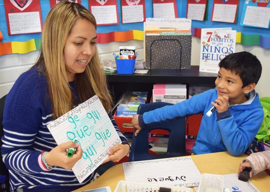 teacher with kindergarten student