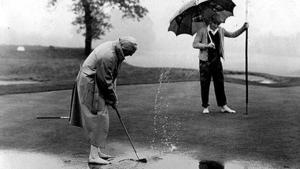golfers in the rain