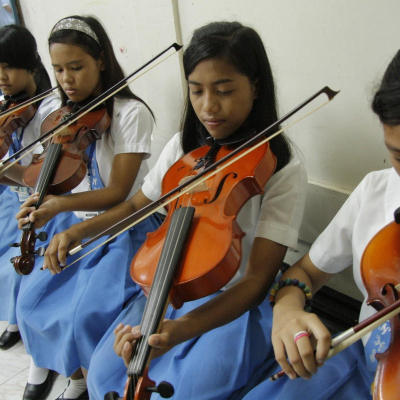 image of students playing instruments