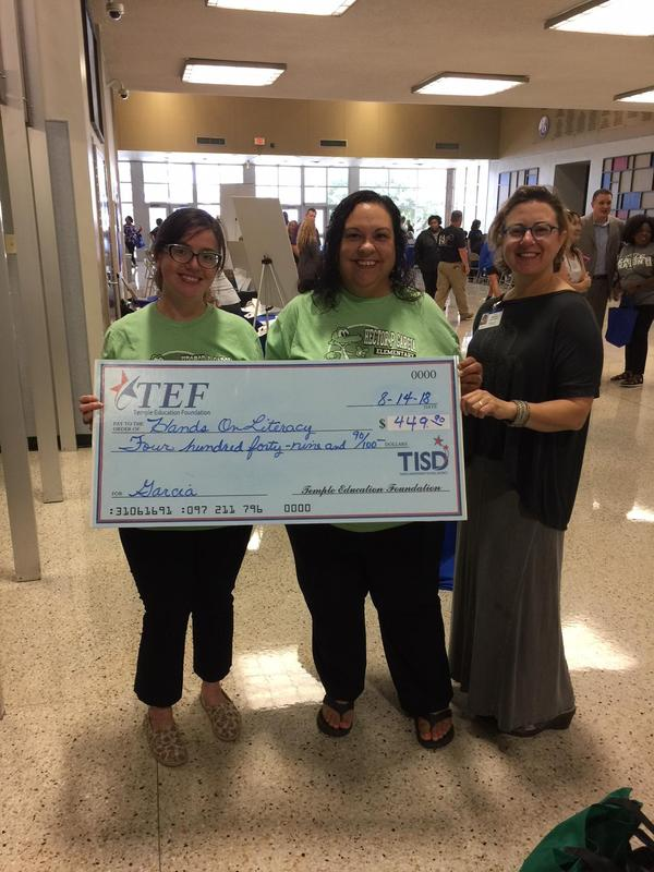 Mrs. Jones and Mrs. Morales receiving grant check from TEF