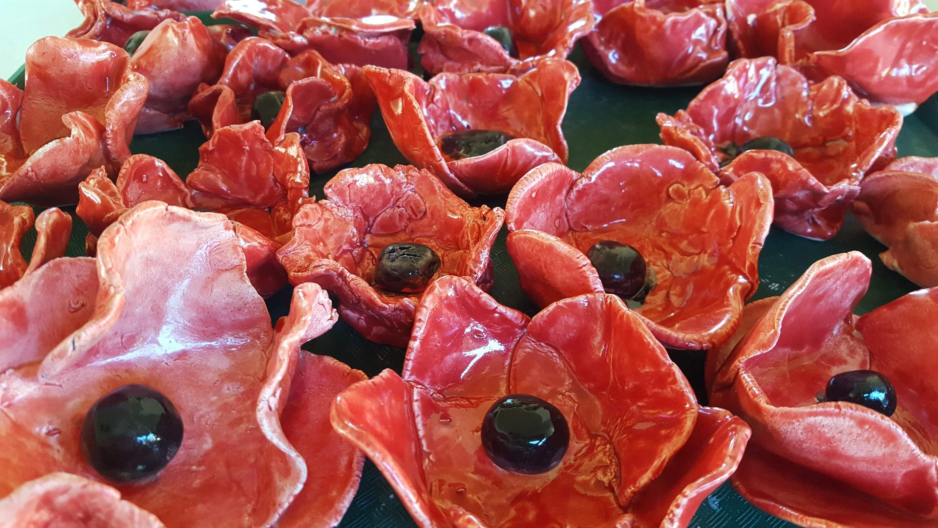 7th grade ceramic poppies for Veteran Day