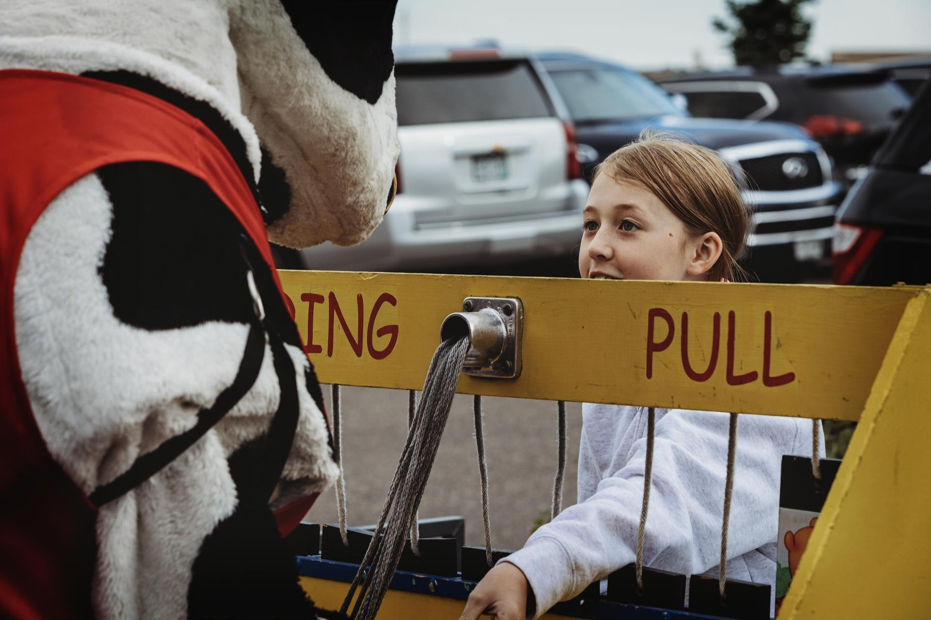 Chick fil-A cow playing carnival game