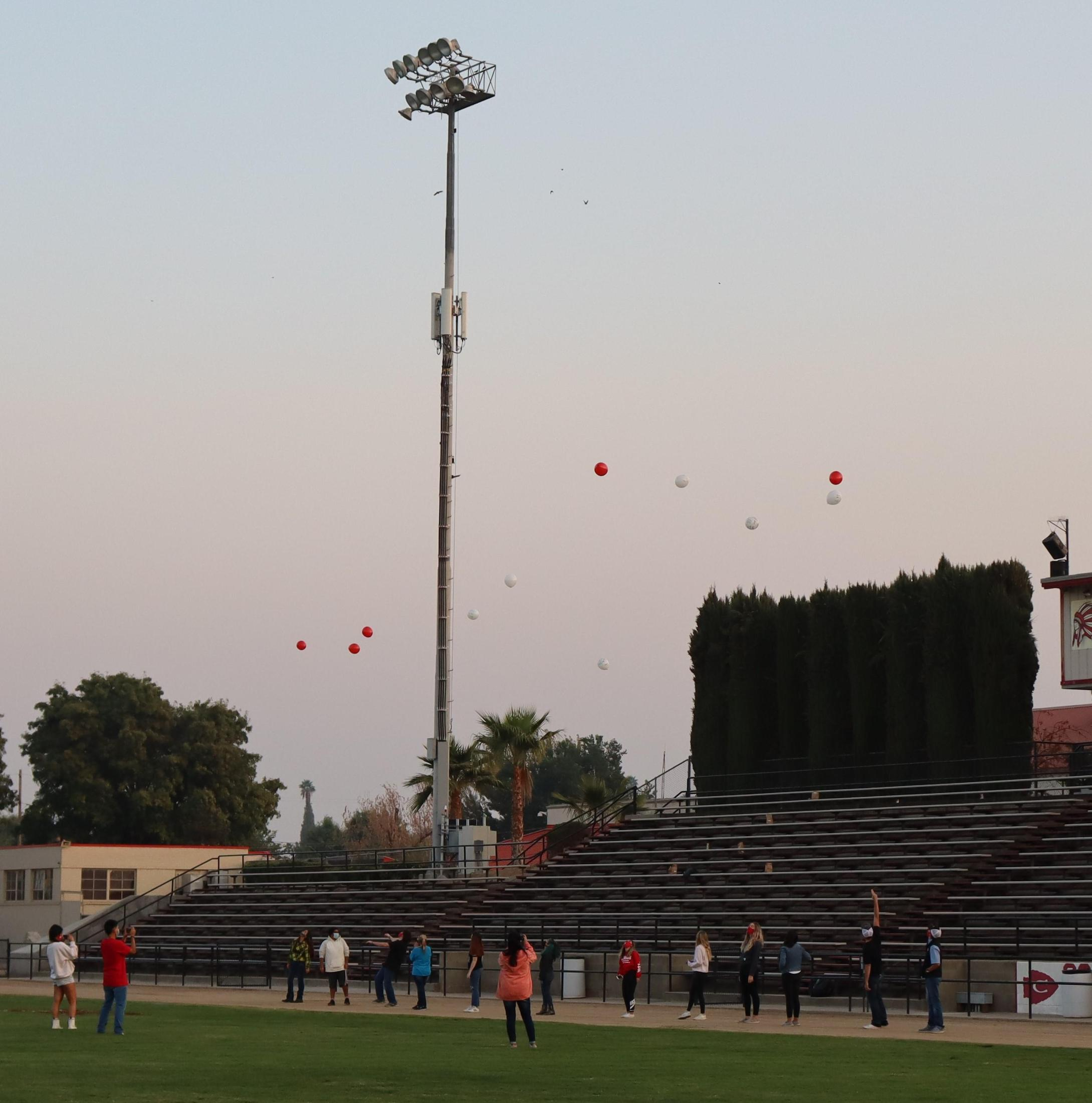 students releasing balloons at senior sunrise