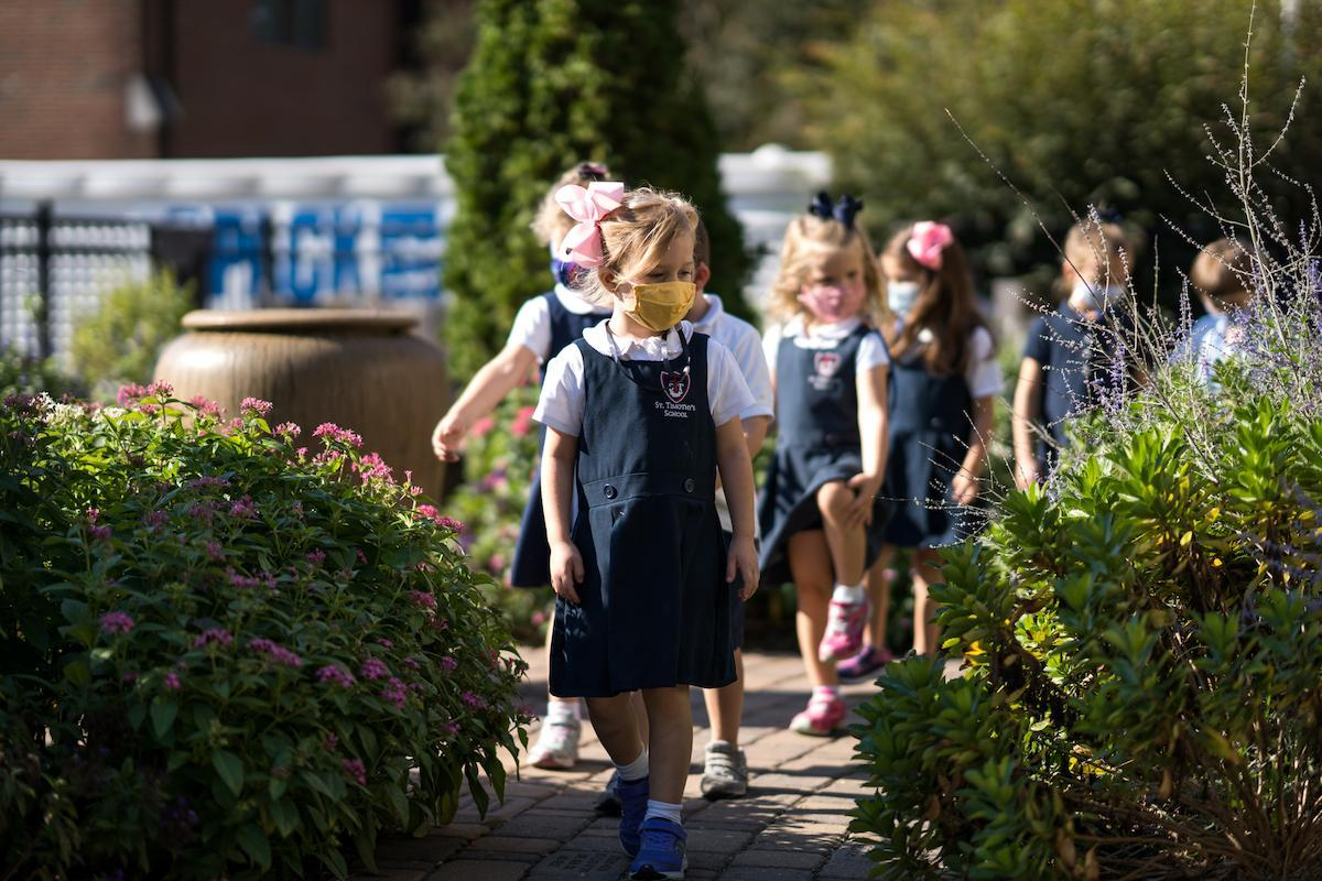 St. Timothy's School pre-kindergarten students walking through learning garden